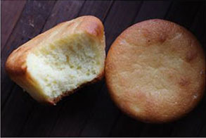 two-pound cake muffins with a bite out of the one on the left