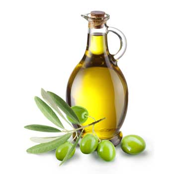 a jug of olive oil with olives in front of it