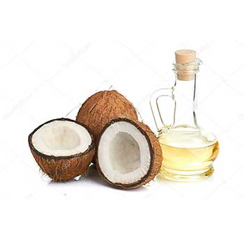 two halves of coconut with one whole coconut and a bottle of coconut oil