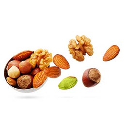 a cup with a variety of nuts almonds macadamia walnuts pistachios